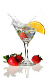 Martini Glass with wedge of lime and strawberries Stock Photography