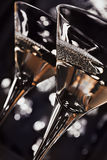 Martini glasses. Two martini  glasses in front of the night lights Stock Photo