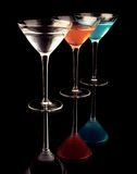 Martini Glasses. Three martini glasses with reflections against a black background, using a black glass photography technique Stock Images
