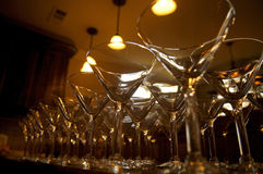 Martini Glasses. Rows of martini glasses taken from a low perspective Stock Images
