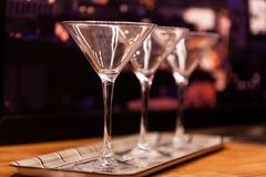 Martini glasses on blurred background. Empty martini glasses on blurred background royalty free stock photos