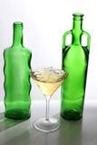 Martini glasses on bottle Stock Photos