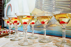 Martini glasses and cherries. On the holiday party Stock Images