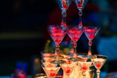 Martini glasses with cherries with red bright illumination. For a party Stock Photography
