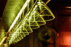 Martini Glasses. Hanging martini glasses in a bar restaurant Royalty Free Stock Images