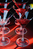 Martini glasses and liquor. Martini glasses and red liquor cocktails Stock Photos
