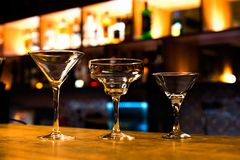 Martini glasses and margaritas. On the bar Stock Images