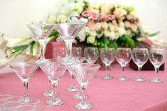 Martini glasses pyramid. On the soft pink fabric Royalty Free Stock Image