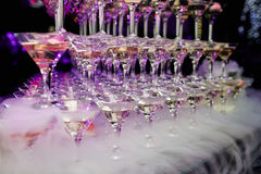 Martini glasses on served table in a restaurant. With flowers Stock Images