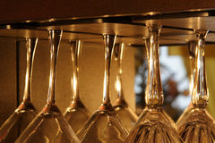 Martini Glasses Upside Down. Martini Glasses hanging upside down Royalty Free Stock Images