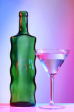 Martini green bottle and one glasses Royalty Free Stock Image
