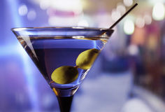 Martini with green olives stock photography