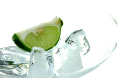 Martini ice. Lime in a glass with Ice stock photos