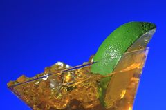 Martini Ice drink and Lime. Ice drink and Lime isolated on blue background Royalty Free Stock Photography