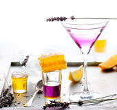 Martini, lavender, honey, lemon cocktail on a white background. Vermouth. Stock Image