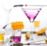 Martini, lavender, honey, lemon cocktail on a white background. Vermouth. Stock Photography