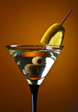 Martini with lemon and green olives Royalty Free Stock Photos