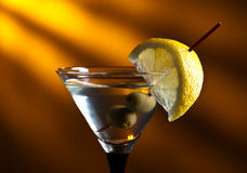 Martini with lemon and green olives Stock Photography