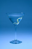 Martini with lemon twist shifted blue. For artistic effect Royalty Free Stock Images