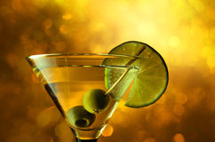 Martini with lime and green olives. Royalty Free Stock Photo