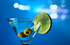 Martini with lime and green olives Stock Photo