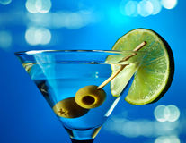 Martini with lime and green olives Stock Image
