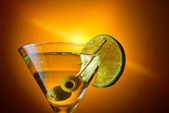 Martini with lime and green olives Stock Images
