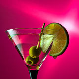 Martini with lime and green olives Royalty Free Stock Photo