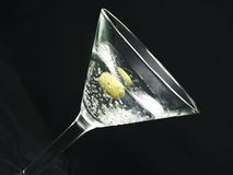 Martini n olive #2. Martini with an olive and bubbles Stock Photography