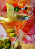 Martini in night light. And of olive Royalty Free Stock Photo