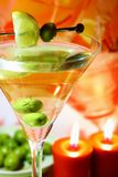 Martini in night light. And of olive Stock Photos