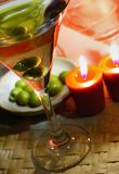 Martini in night light. And of olive Stock Images