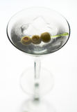 Martini with olive on fancy skewer Stock Photo