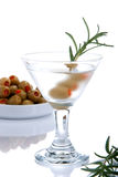 Martini with olives. Classic Martini with olives filled by red papper inside and rosmarin isolated on a white background Royalty Free Stock Photography