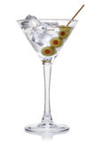Martini with olives and ice cubes. Martini with olives and ice cubes,  on the white background, clipping path included Royalty Free Stock Images