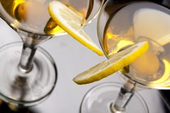 Martini with olives and lemon slice Royalty Free Stock Images