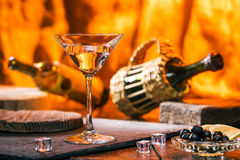 Martini over fireplace lighting Royalty Free Stock Image