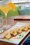 martini pomarańczowi garnka majchery Obrazy Stock