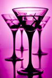 Martini on purple. Four glasses of martini on purple background, shallow depth of field Stock Images