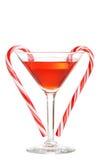Martini rojo con los bastones de caramelo Imagen de archivo