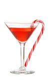 Martini rouge avec une canne de sucrerie Photographie stock