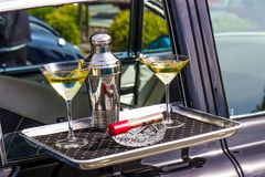 Martini Shaker, Glasses, Ash Tray And Cigar On Car Hop Serving Tray. Martini Shaker, Glasses & Cigar On Car Hop Serving Tray stock image