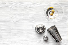 Martini and shaker top view of wooden background stock images