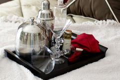 Martini shaker on tray laying on bed Royalty Free Stock Photos