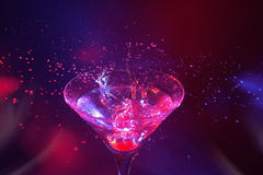 Martini splash. Red cherry splash in martini Royalty Free Stock Photo