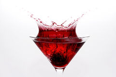 Martini Splash. Highspeed from a falling strawberry into a cosmopolitan Stock Image
