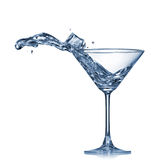 Martini splash in glass isolated Royalty Free Stock Photos
