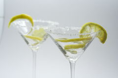 Martini with sugar crust, lemon and peels Stock Images