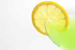 Martini time. Green apple martini with lime on white stock photo