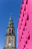 Martini tower and pink building in the center of Groningen Stock Image
